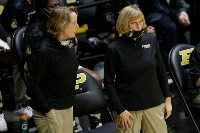 Purdue head coach Sharon Versyp and Purdue associate head coach Beth Couture talk during the third quarter of an NCAA women's basketball game, Thursday, Feb. 11, 2021 at Mackey Arena in West Lafayette.