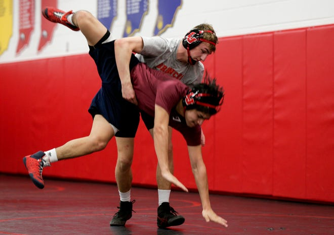 Dylan Baumgartner, top, wrestles a teammate during a practice, Thursday, Feb. 11, 2021 at Lafayette Jeff High School in Lafayette.