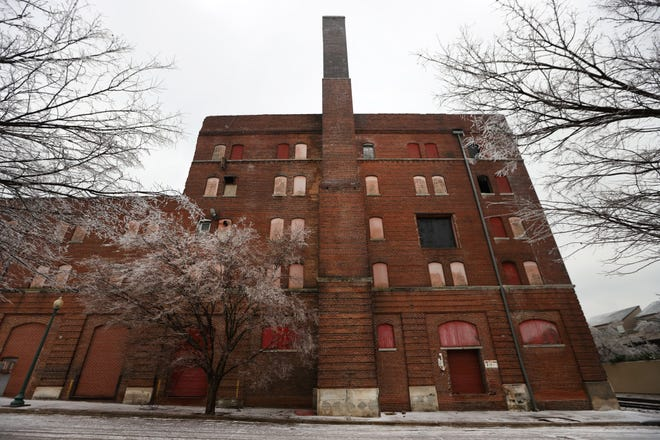 Developers are preparing to tear down the historic Nylon Net building at 7 Vance Avenue downtown to build an apartment complex. However, preservationists have said the building is part of the fabric of downtown and it should be renovated, not razed.