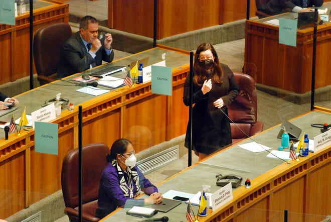 Democratic state Sen. Katy Duhigg of Albuquerque, standing, speaks in support of an effort to shore up abortion rights at the Statehouse in Santa Fe in this Feb. 11, 2021 file photo. Duhigg is the co-sponsor of a bill capping interest rates at 36% annually for low-dollar loans, which the New Mexico Senate passed Tuesday.