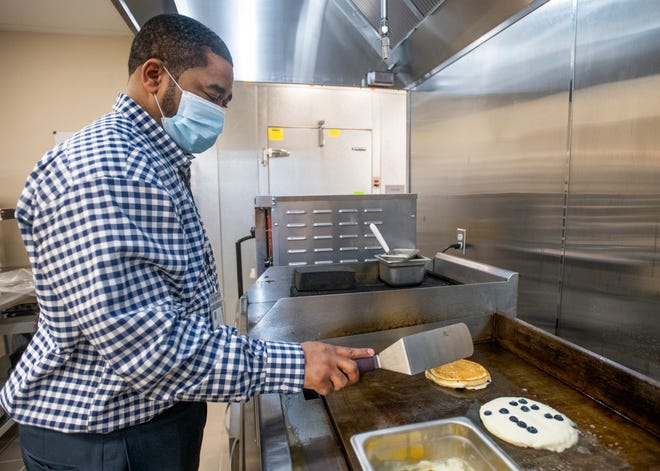 LaMarcus Jordan, food and beverage director, prepares an order of lemon blueberry ricotta pancakes at the Marriott Bistro inside the Courtyard by Marriott in Pensacola on Friday.