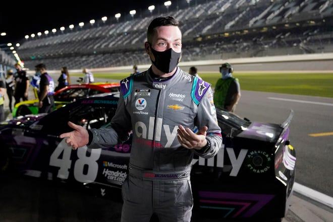 Alex Bowman talks with reporters after winning the pole position for the Daytona 500 during NASCAR auto race qualifying at Daytona International Speedway, Wednesday, Feb. 10, 2021, in Daytona Beach, Fla. (AP Photo/John Raoux)