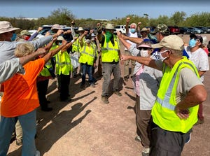 A volunteer group from Green Valley pick up trash along Interstate 19 in September 2020.
