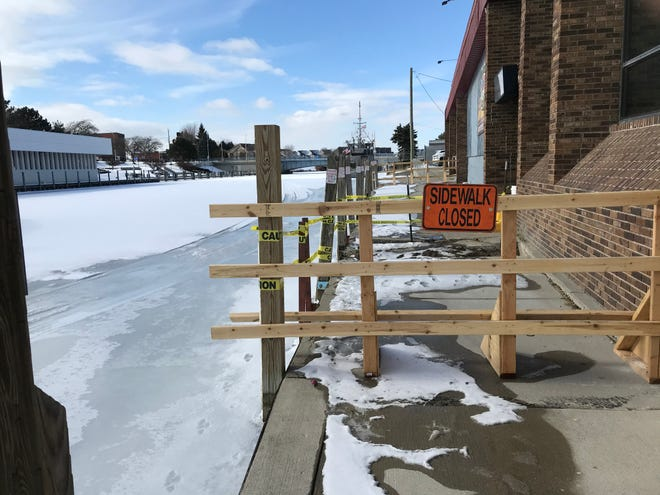 The Black River boardwalk behind the Zebra Bar is shown closed to passers-by on Thursday, Feb. 11, 2021.