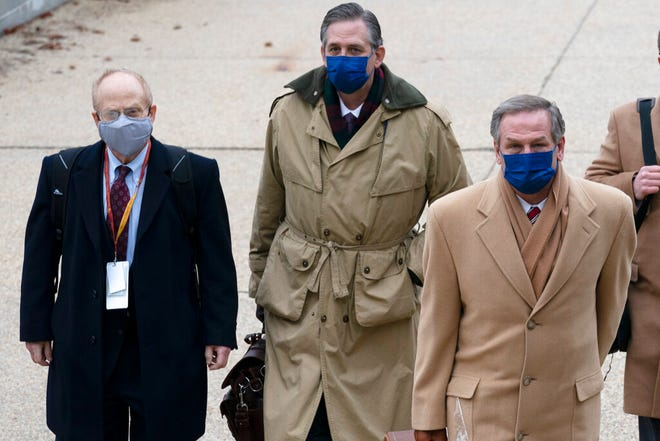 From left, David Schoen, Bruce Castor and Michael van der Veen, lawyers for former President Donald Trump, arrive at the Capitol on the third day of the second impeachment trial of Trump in the Senate, Thursday, Feb. 11, 2021, in Washington. (AP Photo/Jose Luis Magana)