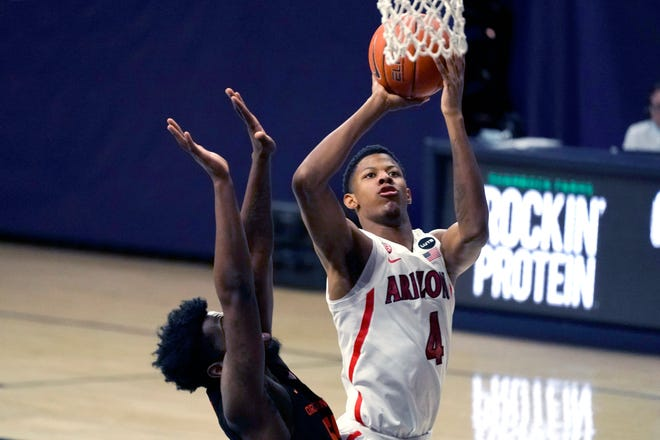 Arizona guard Dalen Terry (4) drives past Oregon State guard Tariq Silver during the first half of an NCAA college basketball game, Thursday, Feb. 11, 2021, in Tucson, Ariz.