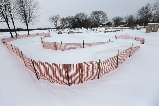 A portion of Pfiffner Pioneer Park in Stevens Point, between the Cultural Commons and the park's pond, is seen fenced off on Thursday. The city of Stevens Point erected the fencing in the summer of 2020 when city staff discovered the area has been polluted.