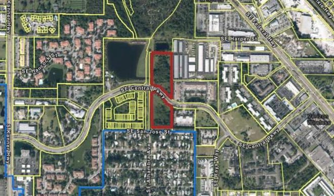 A satellite image shows the proposed development site, outlined in red, for a 196-unit apartment complex on Southeast Central Parkway.