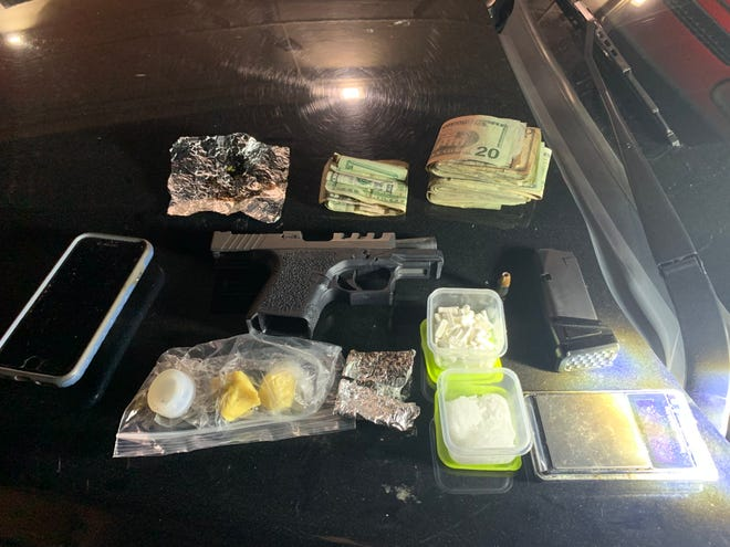 Firearms, narcotics and cash seized during a traffic stop in Ventura on Saturday.