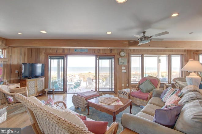 Sliding glass doors lead from the living room to a deck with oceanfront views at this home on Bunting Avenue in Fenwick Island.