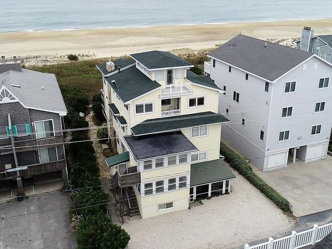 This oceanfront home on Bunting Avenue in Fenwick Island features 11 bedrooms, 9 baths and multiple decks.