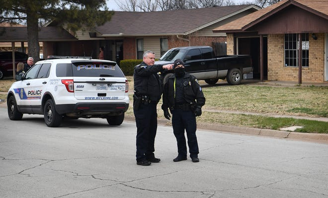 Wichita Falls Police work the scene of a shooting Thursday afternoon in the 4800 block of Colleen Drive that sent one male victim to the hospital with life-threatening injuries.