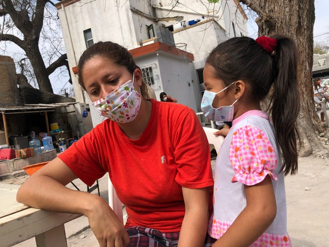 Rosa Dalila Moran, 33, and her daughter, Andrea Cristina, 5, fled their native El Salvador to escape death threats from gangs. They've been living at El Buen Samaritano shelter in Nuevo Laredo, Mexico, since December 2019 as they await a U.S. immigration hearing.