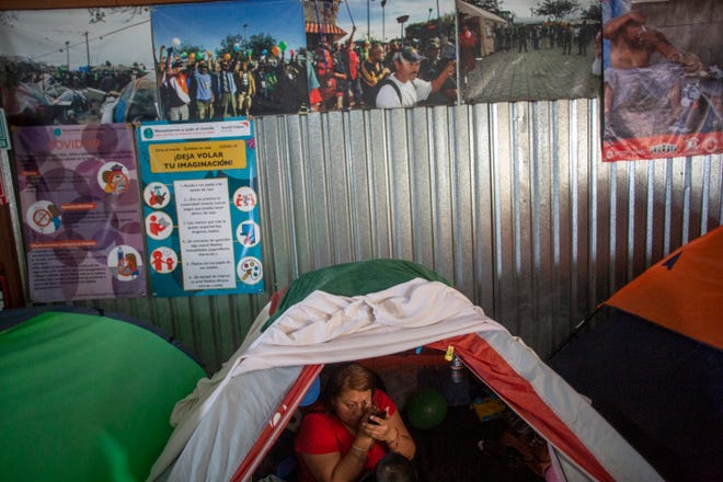 A migrant is photographed at a Tijuana migrant shelter on Feb. 9, 2021. Many migrants are hopeful that they can seek asylum in the U.S.