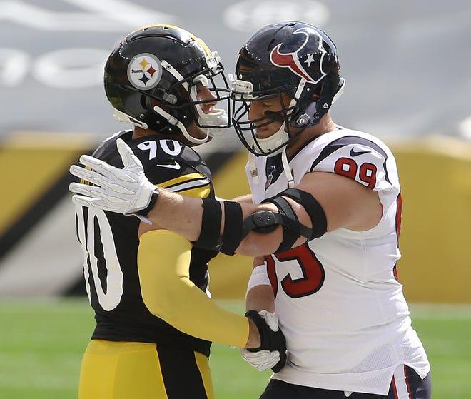 Pittsburgh OLB T.J. Watt (90) and brother J.J. Watt embrace before a Steelers-Texans game at Heinz Field last September.