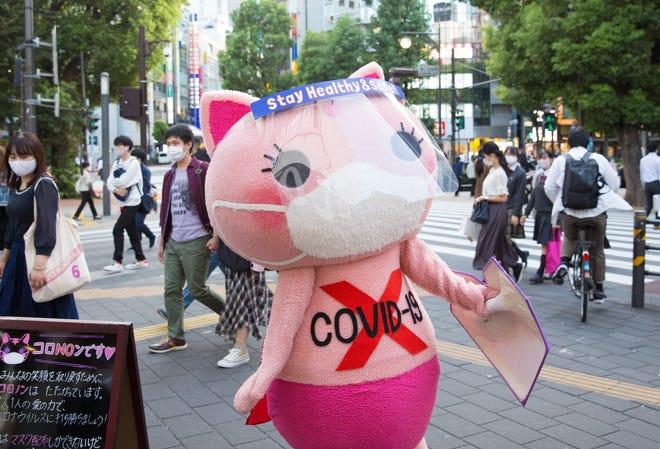Koronon, a Japanese anti-coronavirus cat mascot, raises awareness about COVID-19 in Ikebukuro, Tokyo.