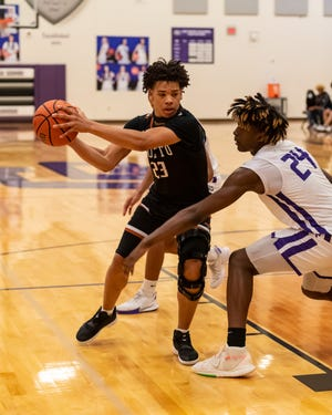 Hutto's Dylon Richardson, left, tries to get past Marcel Bryant of Cedar Ridge during Hutto's 68-61 win over Cedar Ridge in a District 25-6A basketball game Feb. 12 at Cedar Ridge High School.