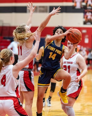 Ariana Rosado drives for Stony Point against, from left, Peyton Ferrell, Mia Galbraith and Kate Gordon of Lake Travis. The Cavs won a Class 6A bidistrict basketball playoff game 52-51 over Stony Point at East View High School on Feb. 12 despite 38 points from Rosado.