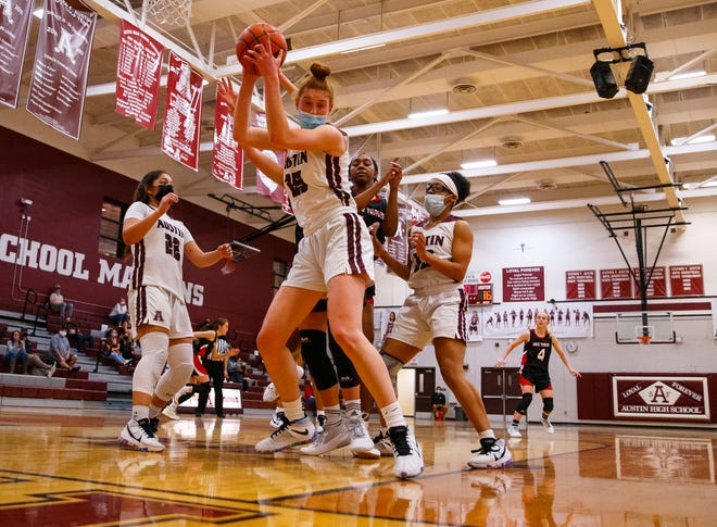 Austin High's Sadie Swift, controlling a rebound against Lake Travis earlier this season, had 10 points, 10 rebounds, two steals and five blocked shots in the Maroons' 50-34 win over Vandegrift in a Class 6A first-round playoff game Friday.