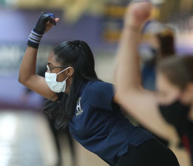 Archbishop Hoban's Ric'Karia Hardley bowls to an individual second-place finish and leads her team to a first-place finish during the Division I high school girls bowling sectional at Stonehenge Family Entertainment on Saturday in Akron. [Karen Schiely/Beacon Journal]