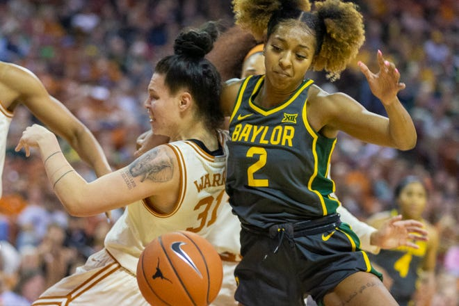 Baylor guard DiDi Richards battles Texas forward Audrey Warren  for a rebound during their game last season in Austin. Baylor has won 22 of the past 23 games against the Longhorns.