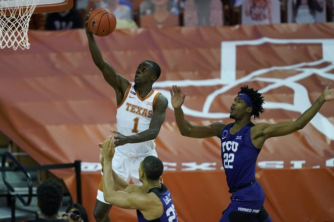 Texas guard Andrew Jones drives to the basket past TCU's RJ Nembhard during the second half of the Longhorns' 70-55 win Saturday.