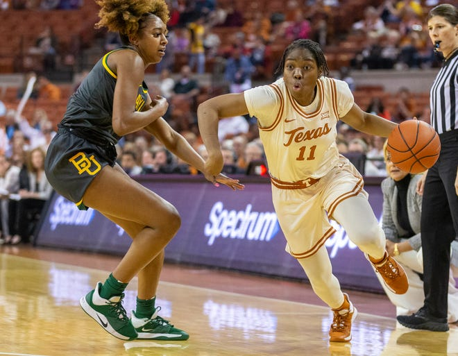 Texas guard Joanne Allen-Taylor drives around Baylor's DiDi Richards in Austin last year. Allen-Taylor is one of four current Longhorns who have played for Texas in a previous game against Baylor.