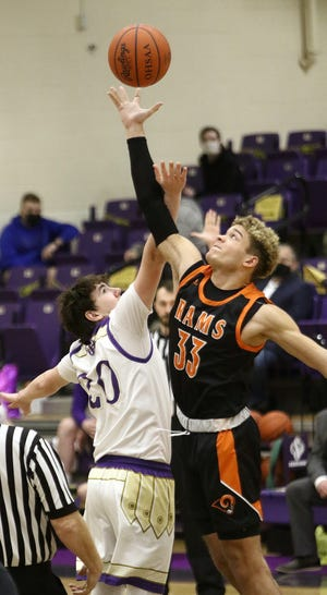Sebring's Dylan Johnson, left, and Mineral Ridge's Triston Weiss during tip-off of their game at Sebring McKinley High School on Friday, February 12, 2021.