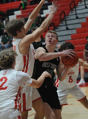 West Branch's Josh Gregory works in the paint against a host of Salem defenders in an Eastern Buckeye Conference game at Salem High School Friday, February 12, 2021.
