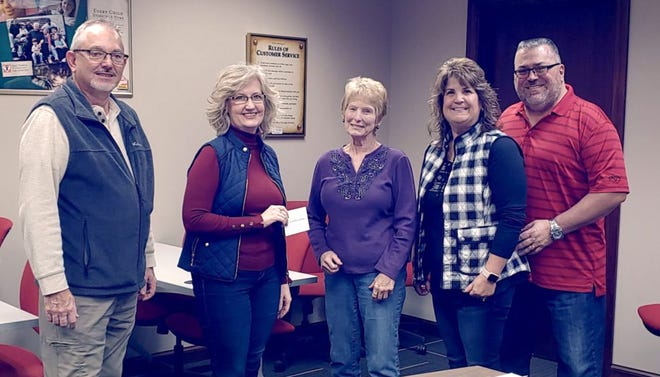 Pastor Dave McNeely (left), Sherry Bouquet, executive director of Fostering Family Ministries , board members Karen Laughery and Debbie Gross and Zane Gross, a business partner, were on hand when a donation of $2,500 was presented to the ministry from the Faith Fund.