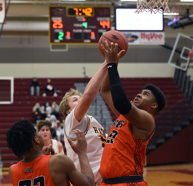 Ames' Corey Phillips beats Ankeny's J.J. Kohl for a rebound during the second half of the No. 6 (4A) Little Cyclones' 56-37 victory over the Hawks Friday in Ankeny. Phillips scored 13 points to help Ames earn its eighth win in a row.
