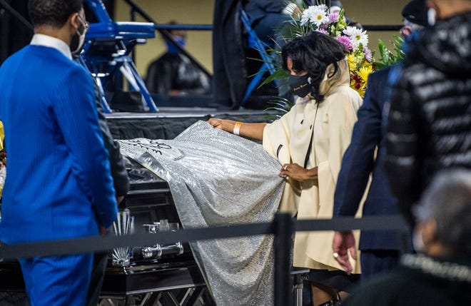 Deanna Brown-Thomas, daughter of the late soul singer James Brown, drapes one of her father's capes over the casket of Danny Ray, the famous emcee and cape man for James Brown, Saturday morning February 13, 2021, at the James Brown Arena in Augusta, Ga. Ray also draped a cape over the casket of James Brown during his funeral in 2006.