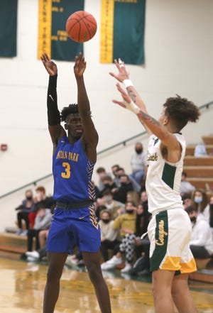 Lincoln Park's Dakari Bradford (3) attempts a three point shot while being guarded by Blackhawk's Lorenzo Jenkins (4) during the first half Friday night at Blackhawk High School.