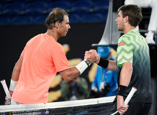 Rafael Nadal, left, shakes hands with Cameron Norrie after winning their third round match at the Australian Open on Saturday.