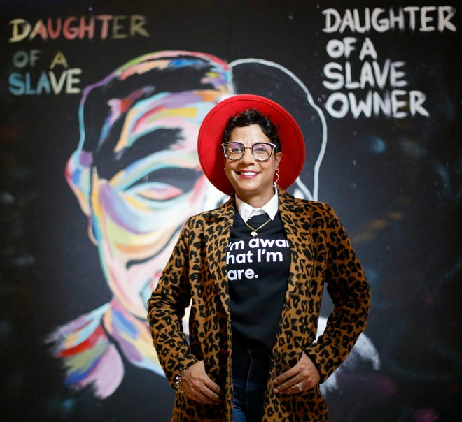 Rita Fuller-Yates poses in front of one of the cubes at Easton Town Center. Four cubes are being designed by local female artists building a story to honor the contributions that Black women have made throughout Columbus' history.