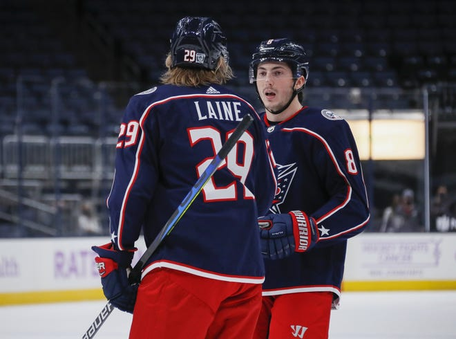 Defenseman Zach Werenski, right, missed three games after being injured in a Feb. 4 game against the Stars.