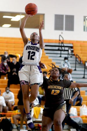 Africentric's Aniyah Murphy scores on a layup over Beechcroft's LaLarra Bays.