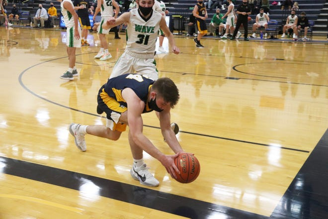 Easton Tangquist tries to keep the ball in play during Crookston's 83-46 loss to East Grand Forks Friday night.