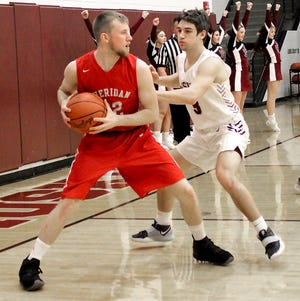 Sheridan's Landen Russell (22) looks for a team mate as John Glenn's Blade Barclay (3) applies defensive pressure during Friday's MVL game in New Concord.