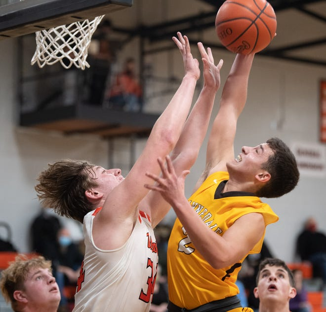 Waynedale's Mateo Camacho (right) challenges Liam Riggenbach.