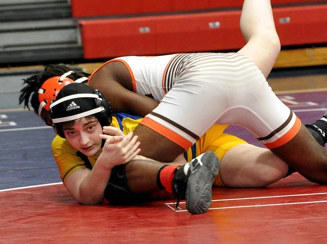 Wooster's Sairra Tapp competes in a 138-pound match earlier this season.