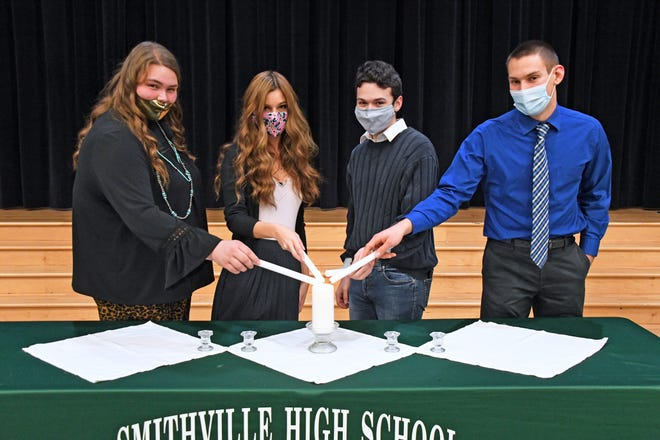 Secretary Morgan Johnson (left) and Treasurer Morgan Danko are shown with new Smithville High School National Honor Society inductees Shawn Koval II and Adrian Dotterer