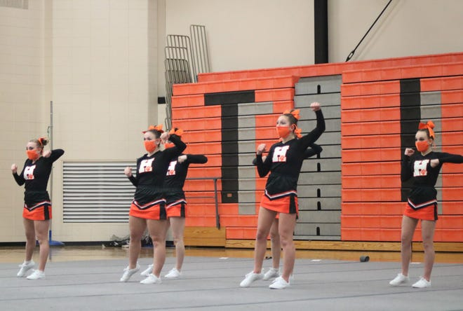 The Hudson competitive cheer team goes through its routine during the second round of Friday evening's jamboree.