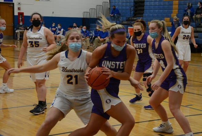 Onsted's Mya Hiram takes the ball away from Summer Smith of Ida Friday night.