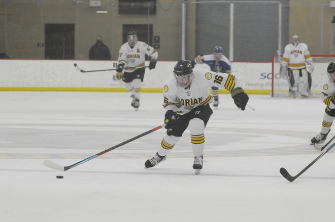 Adrian College's Alessio Luciani skates with the puck during a game against Lake Superior State on Nov. 29.