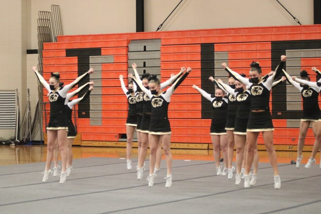The Onsted competitive cheerleading team performs its routine during Friday's jamboree at Hudson. The Wildcats won with a score of 409 points.