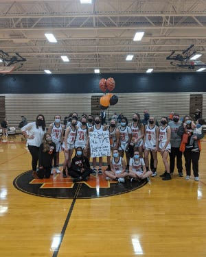 North Davidson's Emily Hege and her teammates celebrate Hege becoming the Black Knights' career scoring leader. [Contributed photo]