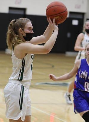 West Burlington High School's Natalie Vandenberg (4) shoots the ball during their Class 3A Region 8 quarterfinal game against Albia High School, Saturday Feb. 13, 2021 at West Burlington.