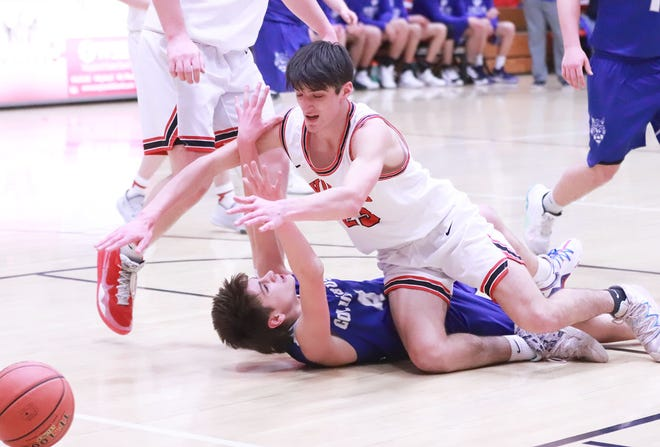 Winfield-Mt. Union's Abram Edwards and Columbus' Brody Frost collide over a loose ball in the Wolves' postseason win.