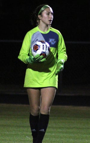 Ponte Vedra goalkeeper Audrey Johnson prepares to release the ball during a high school girls soccer game against Creekside on Jan. 19, 2021.
